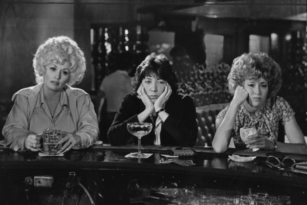 "Office workers Dolly Parton, Lily Tomlin and Jane Fonda commiserate over drinks in ""9 to 5."""